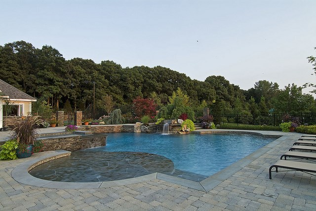 home backyard with the water fountain for swimming pool